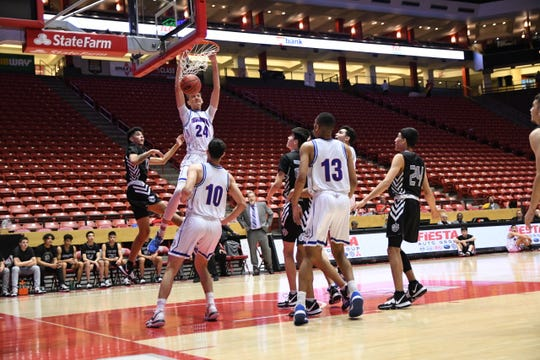 Isaiah Carr slams home a dunk against Capital in the Class 5A state championship game at The Pit in Albuquerque.