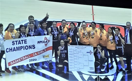 The 2A Girls Champions,  the Mescalero Lady Warriors, celebrate.