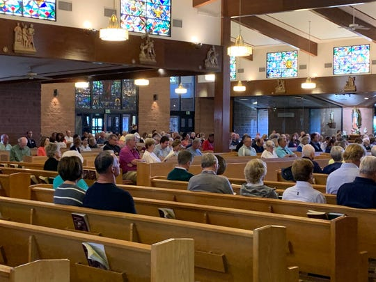 Worshipers attend Sacred Heart Catholic Church in Palm Desert on March 15, 2020.