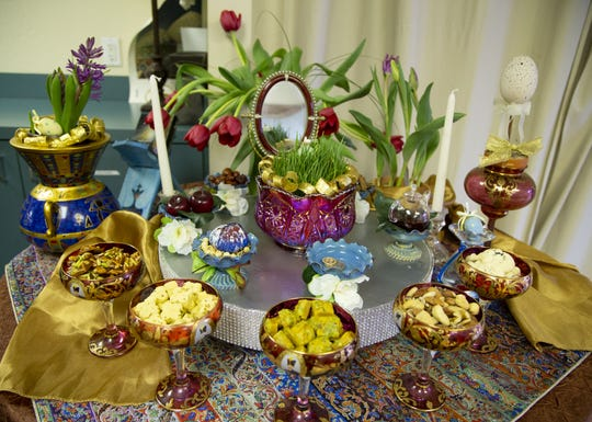 Caterer Vida Shahbazi, decorates a table for the Persian New Year at the Arizona Persian Culture Center in Scottsdale on March 11, 2020.