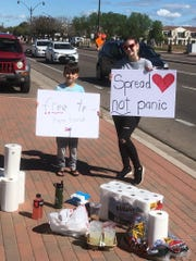 Hailey Brigham and Roman gave away about 50 rolls of toilet paper on Saturday morning.