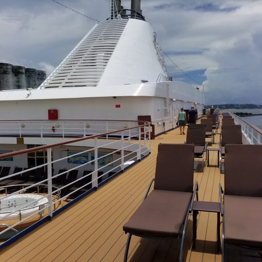 Two passengers aboard the Silversea Silver Shadow were removed from the ship, and the ship has remained docked in the port of Recife, Brazil as of Thursday, March 12, 2020. The result is an empty, quarantined cruise deck.
