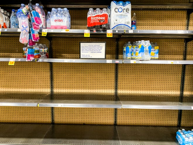 Bottles of water are nearly gone at Fry's grocery store March 15, 2020 in downtown Phoenix.