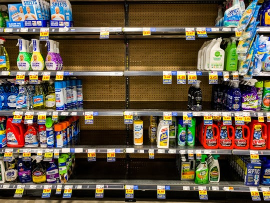 Some cleaning products are bought out at Fry's grocery store March 15, 2020 in downtown Phoenix.