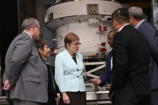U.S. Rep. Marcy Kaptur, D-Toledo, discusses the Orion Artemis 1 spacecraft with officials at NASA Plum Brook Station on Saturday.