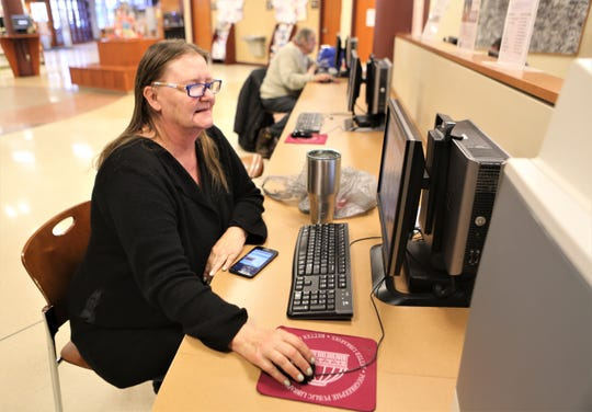 Clarissa Jarred, a Poughkeepsie resident, is seen using a computer at Adriance Memorial Library in the City of Poughkeepsie on Sunday, March 15, 2020.