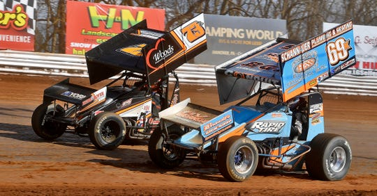 Lance Dewease, in the No. 69 car, passes Brett Michelski (73B) on the inside on his way to a third-place finish at Williams Grove Speedway on Sunday, March 15. That was the last dirt-track race in central Pennsylvania because of the COVID-19 pandemic.  John A. Pavoncello photo
