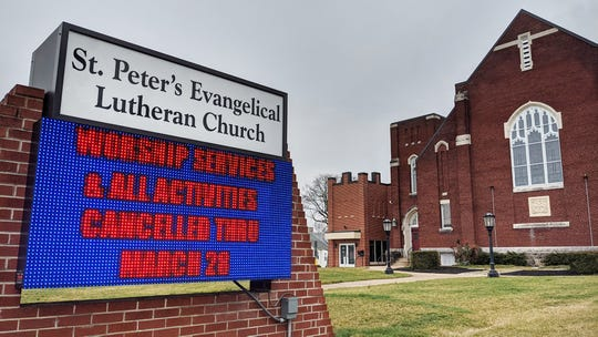St. Peter's Evangelical Lutheran Church in North York displays an electronic warning facing North George St. in North York alerting people that all activities are cancelled through March 28.