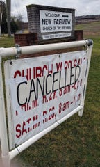 A cancelled sign for an event is in front of New Fairview Church of the Brethren in York Township.