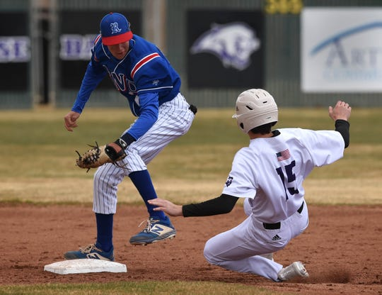 Reno's Patrick Barry looks to tag Spanish Springs' Grant Larson as he slides into second base during Saturday's game at Spanish Springs High School on March 14, 2020. NIAA suspended highs school sports starting on Monday March 16 to help prevent the spread of COVID-16.
