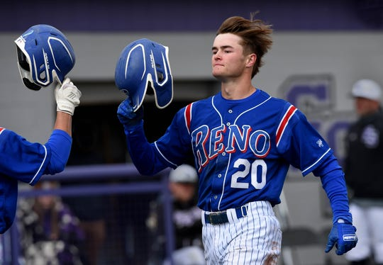 Reno Isaiah Mezger celebrates a home run against Spanish Springs during Saturday's game at Spanish Springs. NIAA suspended highs school sports starting on Monday March 16 to help prevent the spread of COVID-16.