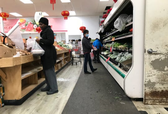 Asian Food Market is busy with shoppers Sunday, March 15, 2020.  Weekends are busier than week days.