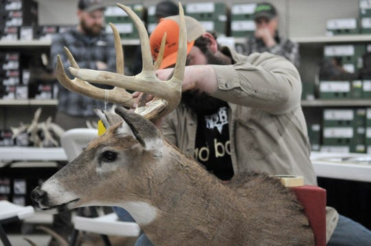 Tanner Smith of Rushville scores a buck during Saturday's event at Runnings in Canandaigua.
