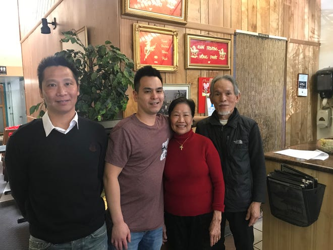 Duc Tran, Alex Nguyen, Hien Tran and Dong Nguyen (left to right) pictured in the dining room at Saigon Vietnamese Restaurant & Grill, the family restaurant they have operated on Court Street NE since 2002.