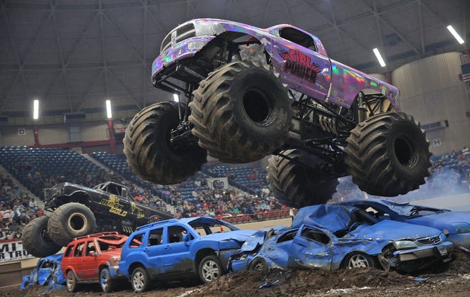 A driver performs a stunt during a monster truck rally at the Foster Coliseum in San Angelo on Saturday, March 14, 2020.