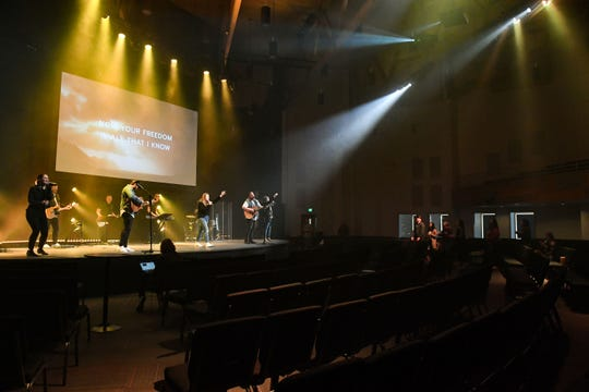 The worship music team performs to a nearly empty room during an Embrace Church service without parishioners on Sunday, March 15, in Sioux Falls. Only a few church staff members were in attendance. The services are live-streamed instead to mitigate concerns about the coronavirus.