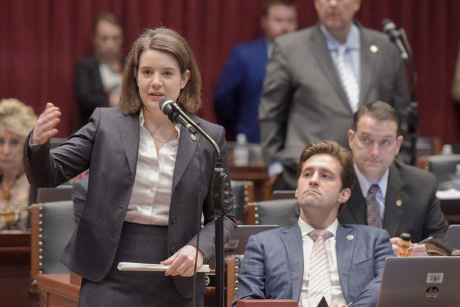 Rep. Mary Elizabeth Coleman, R-Arnold, left, speaks on the Missouri House floor in May 2019.