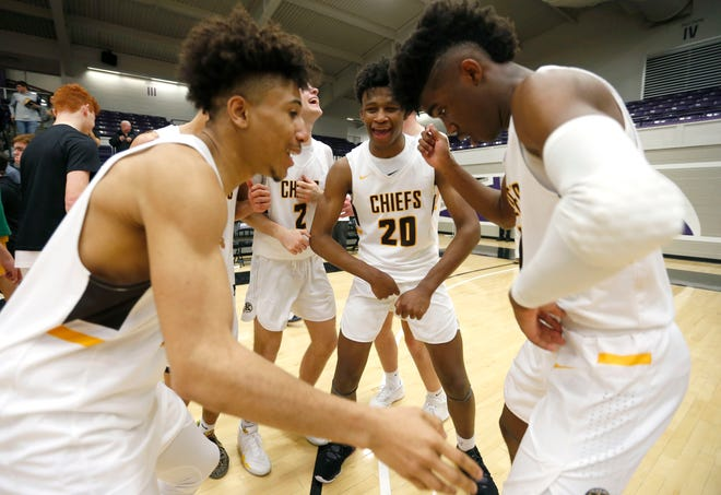 The Kickapoo Chiefs celebrate after beating the Rock Bridge Bruins 67-52 during the Class 5 quarterfinals at Southwest Baptist University in Bolivar, Mo. on Saturday, March 14, 2020.