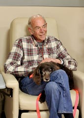 Richard Gardner with his Boykin Spaniel sidekick, Bogey, part of a longtime Animal Therapy team at Tallahassee Memorial HealthCare. Gardner is now fighting stomach cancer.