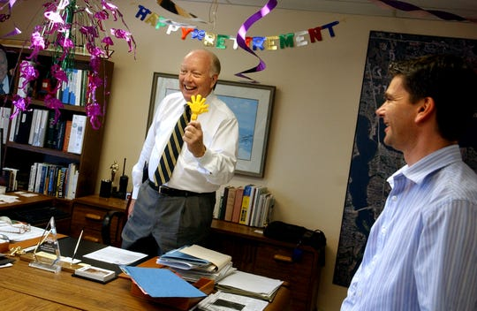 David Collier, The City of Stuart's City Manager, adjourns his last meeting with development director Kevin Freeman, right, purchasing agent Terry Iverson and city attorney Paul Nicoletti, both not pictured, with a set of hand clappers on March 31, 2006.  The finance department decorated Collier's office with pink flamingos, a 'happy retirement' banner and a large clock that is stuck on 5 o'clock.  Collier was appointed to City Manager in 1992.