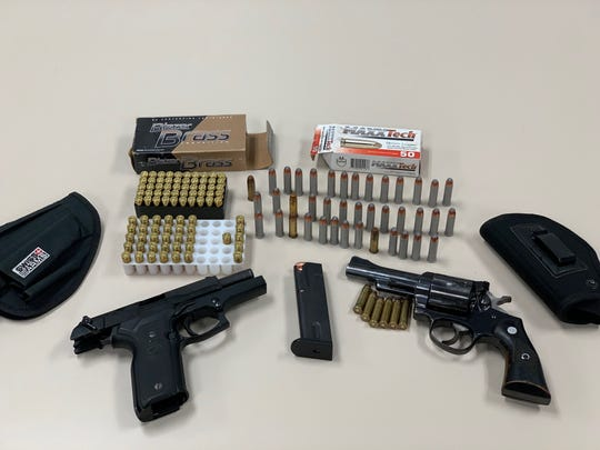 Firearms and ammunition seized during a search warrant in Ventura on Friday.