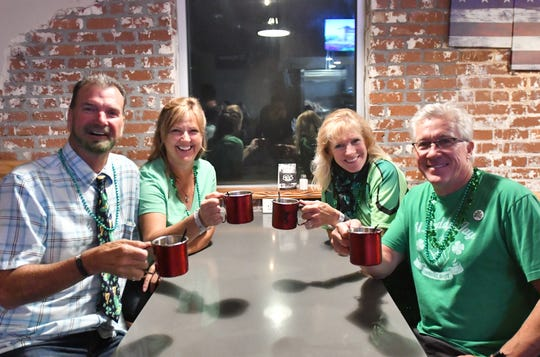 """""""Alcohol is a disinfectant, too."""" Revelers at Stacked Bar and Grill in Visalia celebrate St Patrick's Day on March 14, 2020."""