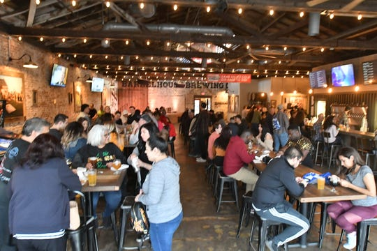Crowds pack the Barrelhouse on Saturday in downtown Visalia. Several downtown Visalia nightspots were busy despite pleas from public health officials to avoid crowds amid fears of spreading the coronavirus.