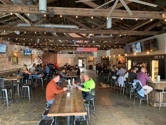 Patrons at Barrelhouse Visalia continue to dine shortly after Gov. Gavin Newsom called on all bars to close across California on Sunday, March 15, 2020.