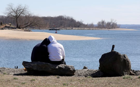 Kate Niewiarowicz and Frank Rego share some quality time as they enjoy the fresh air and sunshine at Sharkey Park in New Rochelle, March 15, 2020.