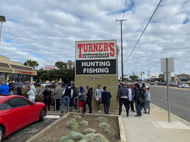 Long lines wait to get into the Turner's Outdoorsman gun store in Torrance, Calif.