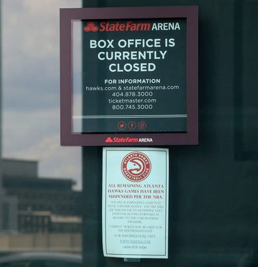 Detailed view of a sign highlighting the suspension of the NBA season at State Farm Arena where a game for March 14, 2020 between the Cleveland Cavaliers and Atlanta Hawks was cancelled due to the coronavirus.