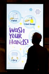 Video display at a Washington, D.C., subway platform on March 13, 2020.