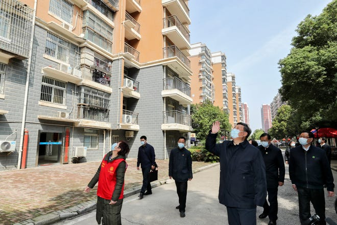 Chinese President Xi Jinping visits a quarantined community in Wuhan in central China's Hubei province on March 10.