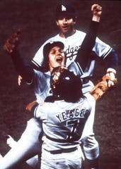 Dodgers pitcher Steve Howe, center, is embraced by teammates after the Dodgers beat the New York Yankees to win the 1981 World Series.
