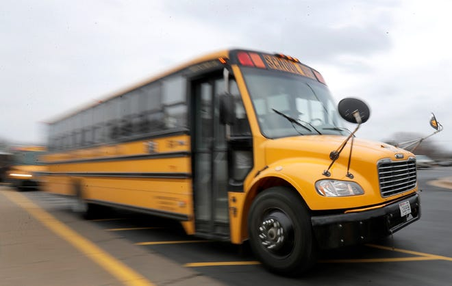 Students leave Neenah High School on Monday. Neenah schools will be closed following Gov. Tony Evers' order for all Wisconsin schools to close by Wednesday.
