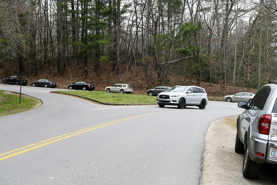 Cars are parked near a trailhead along the Blue Ridge Parkway in Asheville March 16, 2020.
