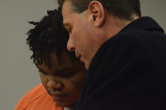 Drequan Scott confers with his attorney, Michael Maddaloni of Lansing.