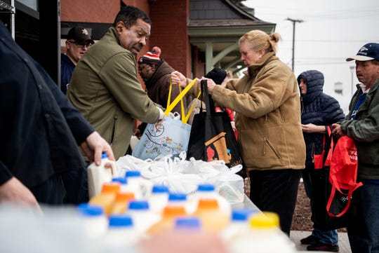 Doug Sturdivant distributes food on Monday, March 16, 2020 at Kendall Street Pantry in Battle Creek, Mich. As the community shuts down to slow the spread of COVID-19, citizens are teaming up to combat food insecurity.