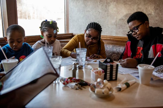 Retired BCPS teacher Brenda Mayaka brings her grandchildren Craig Buchanan III, 5, Chalia Buchanan, 7, Chloe Buchanan, 11, and Cordell Barnes, 12, to Lux Cafe in Battle Creek, Mich. before all Michigan bars and restaurants close at 3 p.m. on Monday, March 16, 2020. Lux Cafe and other Battle Creek businesses are offering free meals for children to combat food insecurity as schools remain closed.
