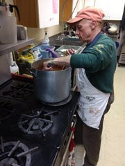 Paul Natelli stirs a pot of spaghetti sauce during The Lord's Table, a free weekly dinner held at Sarah Jane Johnson Memorial United Methodist Church in Johnson City.
