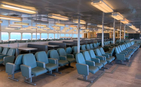 A nearly empty cabin of the 10:00am sailing of the Washington State Ferry Kaleetan from Seattle to Bremerton on Monday, March 16, 2020.