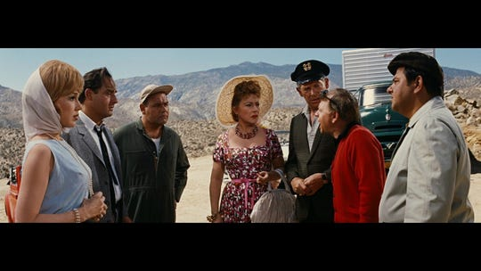 """Mickey Rooney (second from right) lectures fellow travelers, played by (from left) Edie Adams, Sid Caesar, Jonathan Winters, Ethel Merman, Milton Berle and Buddy Hackett, in """"It's a Mad, Mad, Mad, Mad World."""""""