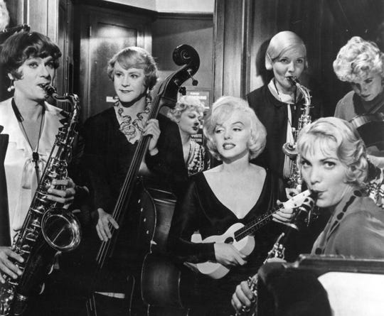 """Marilyn Monroe (middle) has some new """"girls"""" in the band — Tony Curtis and Jack Lemmon (left) — in """"Some Like It Hot."""""""