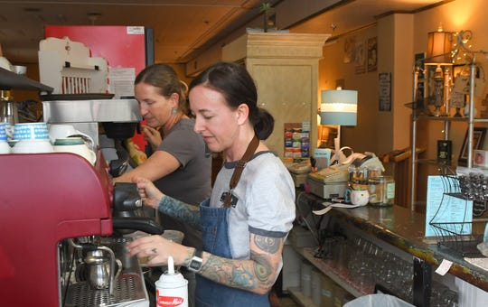 905 Cafe manager Kelly Giles, closest to camera, and owner Heather Tyner work Monday at their 905 E. New Haven Ave. location. This cafe-coffee shop plans to relocate across the street in the near future.