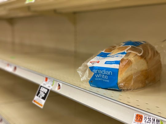 One loaf of bread was as yet unclaimed. Bare shelves at grocery stores like this Williston, VT Hannaford on March 15, 2020 show what is most popular with shoppers staying home to ward off COVID-19.