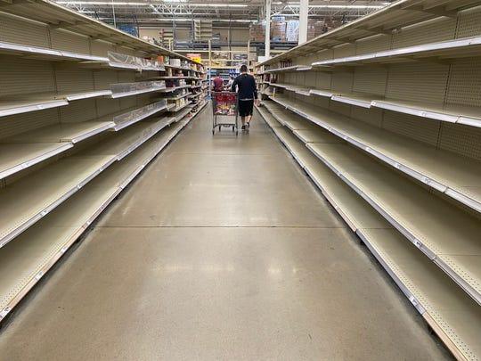 Store shelves were hard to keep stocked at the H-E-B on Saratoga Boulevard amid threats of coronavirus spreading nationwide.