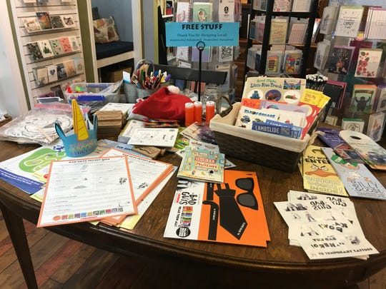 A table inside Inkwood Books in Haddonfield offers free takeaways for kids, including activity pages, stickers, temporary tattoos and craft kits.