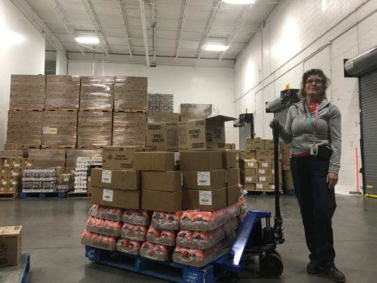 A Food Bank of South Jersey team member works in the Pennsauken warehouse.