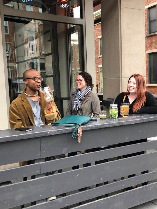 Anthony Buchanan, 28, of Northside, a friend, and Kelsey Rider, 24, of Harrison, Ohio enjoy a drink at 16-Bit Bar and Arcade just after DeWine orders bars closed at 6 p.m. that night, Sunday, March 15, 2020.