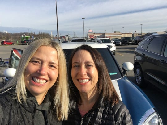 Amy Murray, right, with her sister Sarah Hammelrath, on a road trip to Washington D.C. where Murray was sworn into a job with the Trump administration on March 16, 2020.